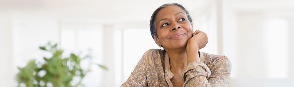 An older woman looking up, smiling